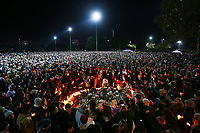 Mourners pay their respects during a vigil held in memory of murdered Melbourne comedian, 22-year-old Eurydice Dixon, at Princess Park on June 18, 2018 in Melbourne, Australia. Dixon was murdered as she walked home through Princes Park on Wednesday following a comedy performance in the city.