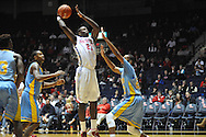 "Ole Miss' center Dwight Coleby (23) scores over Southern University Jaguars center Frank Snow (22) at the C.M. ""Tad"" Smith Coliseum in Oxford, Miss. on Thursday, November 20, 2014. (AP Photo/Oxford Eagle, Bruce Newman)"