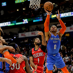 Dec 12, 2018; New Orleans, LA, USA; Oklahoma City Thunder guard Russell Westbrook (0) shoots over New Orleans Pelicans guard Andrew Harrison (1) during the first quarter at the Smoothie King Center. Mandatory Credit: Derick E. Hingle-USA TODAY Sports