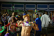 A man flashes his chest on Bourbon Street during Mardi Gras in New Orleans, Louisiana.