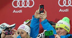 13.02.2013, Medal Plaza, Schladming, AUT, FIS Weltmeisterschaften Ski Alpin, Teambewerb, Siegerehrung, im Bild Michaela Kirchgasser (AUT), Marcel Hirscher (AUT) und Nicole Hosp (AUT), 1. Platz, mit ihren Smartphones // 1st place Michaela Kirchgasser (AUT), Marcel Hirscher (AUT) and Nicole Hosp (AUT) with their smartphones at the Winner Award Ceremony for Nation Team Event at the FIS Ski World Championships 2013 at the Medal Plaza, Schladming, Austria on 2013/02/13. EXPA Pictures © 2013, PhotoCredit: EXPA/ Martin Huber