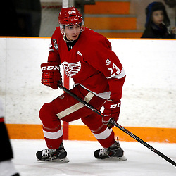 STOUFFVILLE, ON - Feb 2 : Ontario Junior Hockey League Game Action between the Stouffville Spirit Hockey Club and the Hamilton Red Wings Hockey Club.  Niko Porikos #23 of the Hamilton Red Wings Hockey Club skates after the puck during second period game action. <br /> (Photo by Michael DiCarlo / OJHL Images)