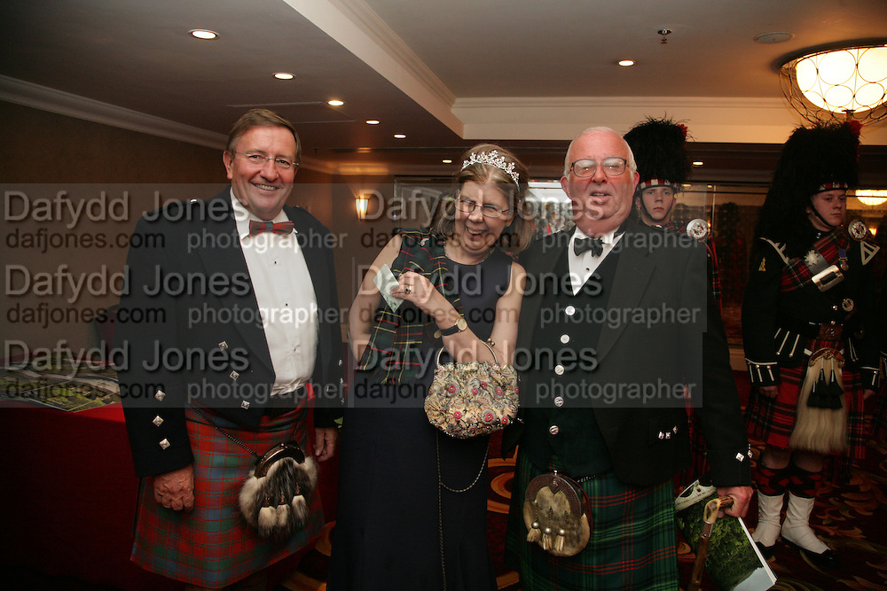 David Reid Chairman of Tesco, Mrs. Nicholas Bardswell and Brain Ross. The Royal Caledonian Ball 2007. Grosvenor House. 4 May 2007.  -DO NOT ARCHIVE-© Copyright Photograph by Dafydd Jones. 248 Clapham Rd. London SW9 0PZ. Tel 0207 820 0771. www.dafjones.com.