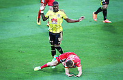 Phoenix' Roly Bonevacia trips Adelaide United's Stefan Mauk during the Round 22 A-League football match - Wellington Phoenix V Adelaide United at Westpac Stadium, Wellington. Saturday 5th March 2016. Copyright Photo.: Grant Down / www.photosport.nz