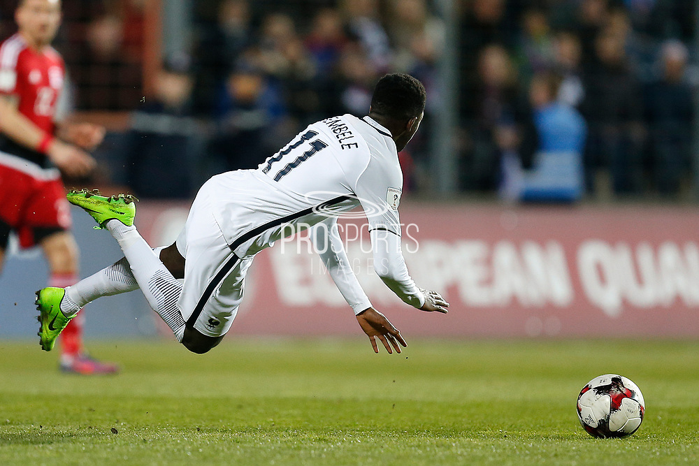 France's forward Ousmane Dembele is tackled during the FIFA World Cup 2018 qualifying football match, Group A, between Luxembourg and France on March 25, 2017 at Josy Barthel stadium in Luxembourg - Photo Benjamin Cremel / ProSportsImages / DPPI