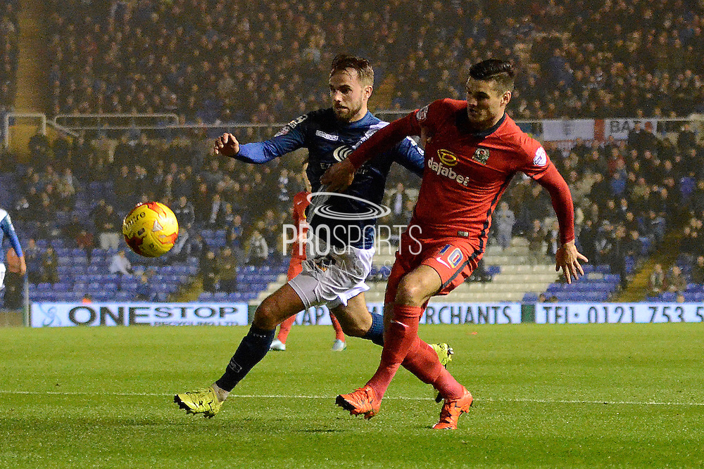 Birmingham City midfielder Andrew Shinnie tussles with Blackburn Rovers midfielder Ben Marshall during the Sky Bet Championship match between Birmingham City and Blackburn Rovers at St Andrews, Birmingham, England on 3 November 2015. Photo by Alan Franklin.