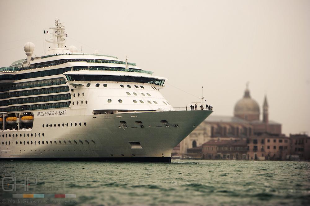 Cruise ship dwarfs Venice as it departs.