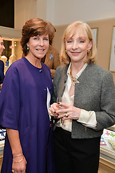 Left to right, HARRIET McCALMONT and LADY ELIZABETH ARNOLD at a preview of the latest collections by jewellery designer Kiki Mcdonough and fashion label Beulah held at Kiki McDonough Jewellery, 12 Symons Street, London on 5th March 2014.