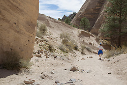 man walking alone in Tent Rocks National Monument in New Mexico