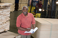 Senior man stock-taking in warehouse