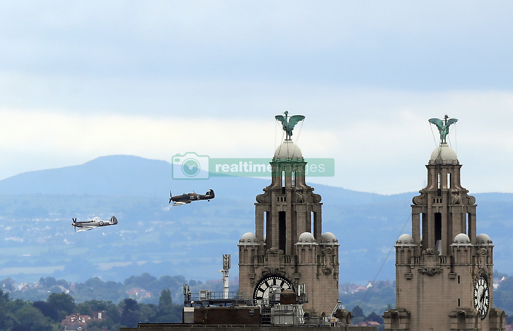 The Battle of Britain Memorial Flight passes the Royal Liver Buildings during the ninth annual Armed Forces Day in Liverpool.