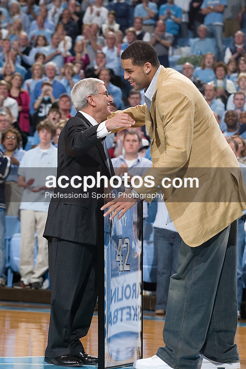 31 December 2006: North Carolina athletic director Dick Baddour and Sean May (right) as the jerseys for former players Sean May, Raymond Felton and Rashad McCants were honored and hung in the Dean Smith Center during a North Carolina Tar Heels 81-51 win over the Dayton Flyers in Chapel Hill, NC.<br />