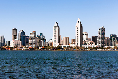high resolution photo of san diego city skyline downtown buildings along the san diego bay waterfront