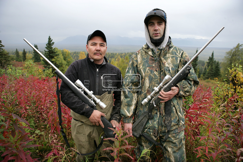 14th September 2008, Wasilla, Alaska.  Lifelong hunters Thomas Agoney, 37,(left) and Shawn Meiller, 31. hunting on Baldy mountain overlooking Wassila 15 miles below. Wasilla is the home town of Republican vice presidential pick, Sarah Palin..PHOTO © JOHN CHAPPLE / REBEL IMAGES.tel: +1-310-570-910