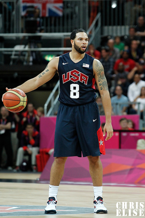 04 August 2012: USA Deron Williams looks to pass the ball during 99-94 Team USA victory over Team Lithuania, during the men's basketball preliminary, at the Basketball Arena, in London, Great Britain.