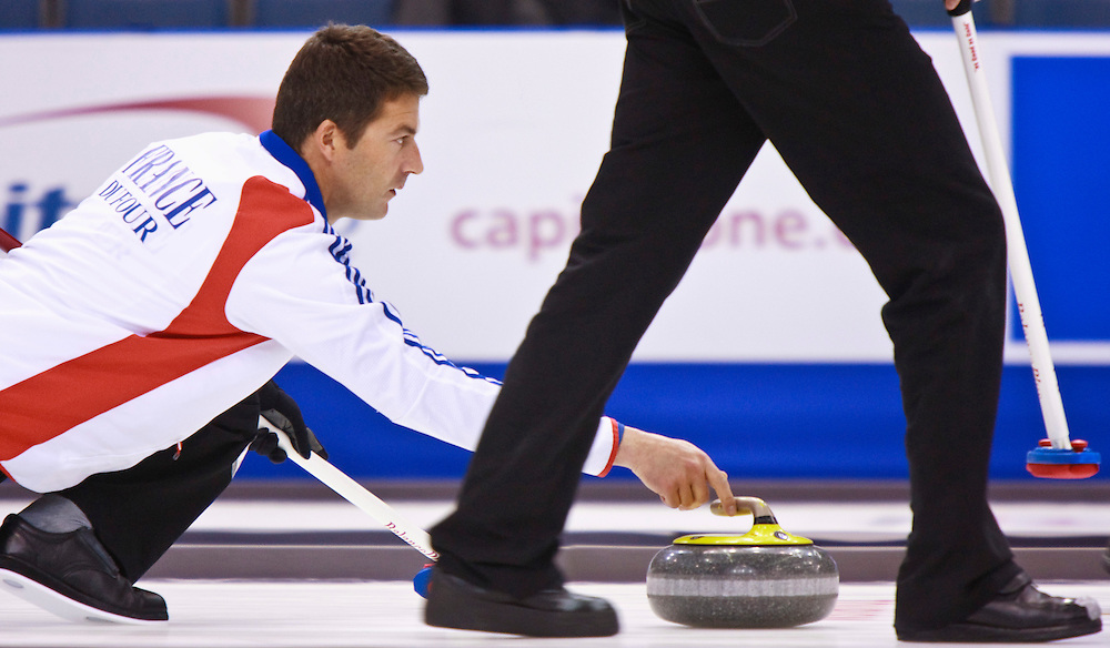 French skip Thomas Dufour, releases his stone during France's tie breaker against Norway at the Ford World Men's Curling Championships in Regina, Saskatchewan, April 8, 2011.<br /> AFP PHOTO/Geoff Robins