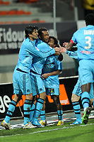 FOOTBALL - FRENCH CHAMPIONSHIP 2009/2010  - L1 - FC LORIENT v OLYMPIQUE MARSEILLE - 16/12/2009 - PHOTO PASCAL ALLEE / DPPI - JORDAN AYEW (OM) CELEBRATES HIS GOAL WITH LUIS OSCAR GONZALEZ (L) AND BAKY KONE (R)