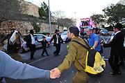 Israel, Haifa, Jewish men celebrating the introduction of a new Torah scroll to the Ramat Sapir Synagogue