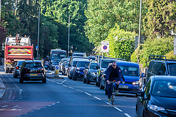 © Licensed to London News Pictures. 15/05/2020. London, UK. Traffic builds up on Putney Hill in South West London as commuters head in to the city as the Government urges people not to use public transport where possible after it relaxed the law on lockdown to let people go to work if you can't work from home and spend more time outside while following social distancing guidelines. Photo credit: Alex Lentati/LNP