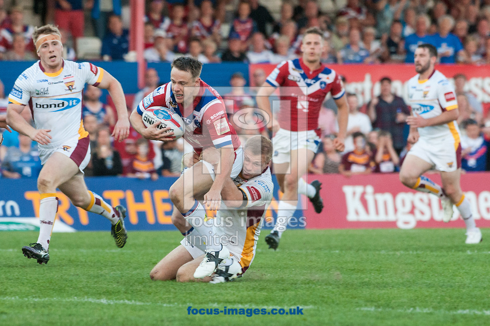 Danny Kirmond of Wakefield Trinity is tackled by Aaron Murphy of Huddersfield Giants during the Betfred Super League match at Belle Vue, Wakefield<br /> Picture by Matt Wilkinson/Focus Images Ltd 07814 960751<br /> 26/05/2017