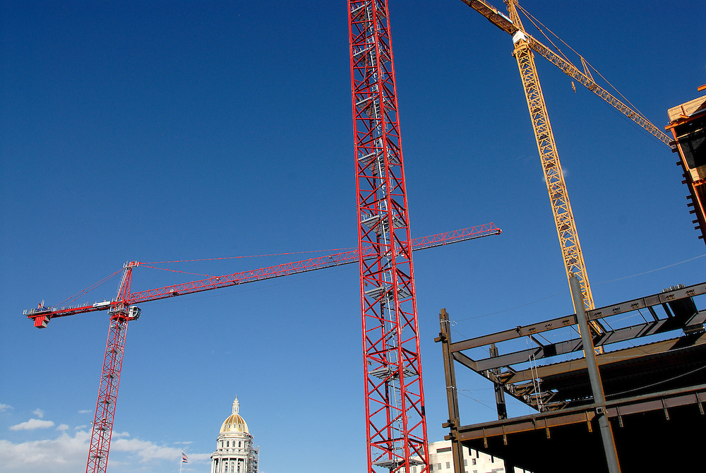 Construction progresses on a building near the state capital in downtown Denver.