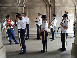 © licensed to London News Pictures. LONDON, UK.  06/06/11. The USA Army Band wait in Horse Guards for the rehearsal. The United States Army Band join with the Massed Bands and Corps of Drums of the Household Division to rehearse Beat Retreat at Horse Guards Parade. The event takes place on 8th and 9th June for featuring the US band the first time. The US visit comes two weeks after the State visit to London of the US President..  Photo credit should read Stephen Simpson/LNP