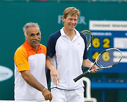 Liverpool, England - Friday, June 15, 2007: Mansour Bahrami and Peter Fleming in actions during the Legends Doubles on day four of the Liverpool International Tennis Tournament at Calderstones Park. For more information visit www.liverpooltennis.co.uk. (Pic by David Rawcliffe/Propaganda)