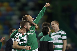 April 18, 2018 - Lisbon, Portugal - Sporting's forward Bas Dost (R)  celebrates his team victory with Sporting's defender Stefan Ristovski (L)   at end of Portuguese Cup 2017/18 match between Sporting CP vs FC Porto, in Lisbon, on April 18, 2018. (Credit Image: © Carlos Palma/NurPhoto via ZUMA Press)
