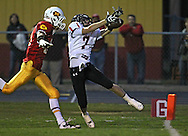 Washington's Gage Redlinger (7) can't pull in a pass as Marion's Quinn Cannoy (11) defends during their game at Thomas Park Field in Marion on Friday, September 20, 2013.