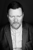 Actor Ian Puleston-Davies demonstrates his acting ability in this black and white portrait of a man with a lot on his mind.