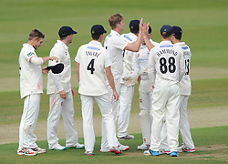 Craig Miles of Gloucestershire celebrates with his team mates after bowling out Ashwell Prince of Lancashire Cricket - Photo mandatory by-line: Dougie Allward/JMP - Mobile: 07966 386802 - 07/06/2015 - SPORT - Football - Bristol - County Ground - Gloucestershire Cricket v Lancashire Cricket - LV= County Championship