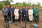 "Members of one of the female demining teams in Khammuan Province, Laos...Laos was part of a ""Secret War"", waged within its borders primarily by the USA and North Vietnam.  Many left over weapons supplied by China and Russia continue to kill.  However, between 90 and 270 million fist size cluster bombs were dropped on Laos by the USA, with a failure rate up to 30%.  Millions of live cluster bombs still contaminate large areas of Laos causing death and injury.  The US Military dropped approximately 2 million tons of bombs on Laos making it, per capita, the most heavily bombed country in the world. ..The women of Mines Advisory Group (MAG) work everyday under dangerous conditions removing unexploded ordinance (UXO) from fields and villages...***All photographs of MAG's work must include (either on the photo or right next to it) the credit as follows:  Mine clearance by MAG (Reg. charity)***."