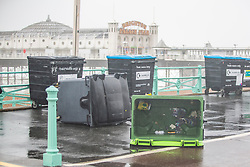 © Licensed to London News Pictures. 02/11/2019. Brighton, UK. Bins are strewn across the Brighton and Hove promenade as powerful waves and strong gusts of wind up to 80 mph are hitting the seaside resort. Photo credit: Hugo Michiels/LNP