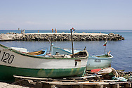 Boats on the shore, central Pomorie..Pomorie is a town and seaside resort in southeastern Bulgaria, located on a narrow rocky peninsula in Burgas Bay on the southern Bulgarian Black Sea Coast. It is located in Burgas Province 20 km from Burgas and 18 km from Sunny Beach. The ultrasaline lagoon Lake Pomorie, the northernmost of the Burgas Lakes, lies in the immediate proximity..It is the center of Pomorie Municipality..Pomorie is an ancient city and today an increasingly popular tourist destination. As of September 2005 it had a population of 14,600...Båter på stranda i Pomorie by..Hest og kjerre er fortsatt et vanlig syn i Pomorie..Pomorie ligger sør på Svartehavskysten, 20 km nord for Burgas og 18 km sør for Sunny Beach. Pomorie er en gammel by, med tiltakende turisme, og hadde pr september 2005 14 600 innbyggere.