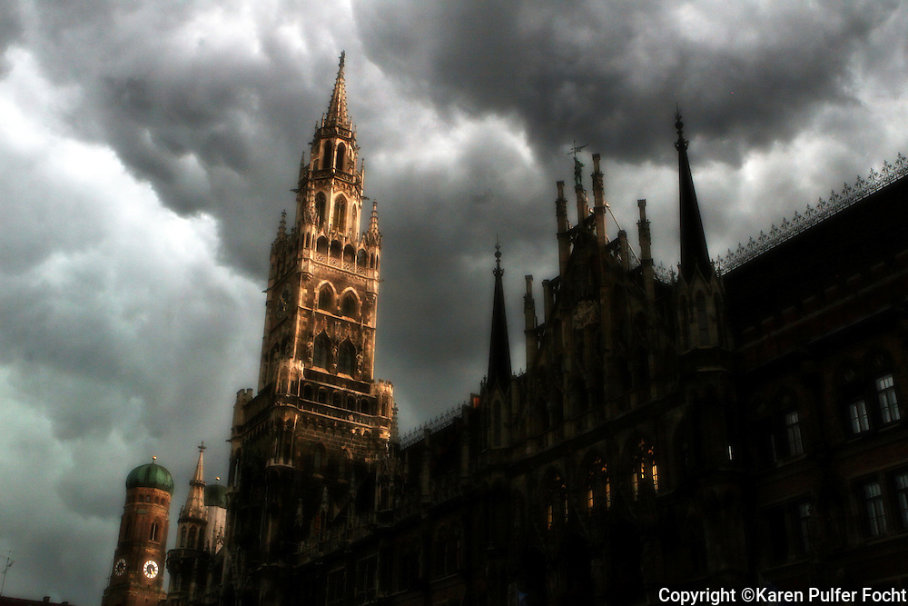 A storm rolls in over Marienplatz,  is a central square in the city centre of Munich, Germany. It has been the city's main square since 1158.