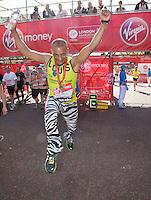Louis Mariette  at the end of the Virgin Money London Marathon 2014 on Sunday 13 April 2014<br /> Photo: Roger Allan/Virgin Money London Marathon<br /> media@london-marathon.co.uk