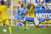 Peterborough No 9 Shaquile Coulthirst is fouled in the  Friendly match between Peterborough United and Leeds United at London Road, Peterborough, England on 23 July 2016. Photo by Nigel Cole.