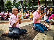 13 OCTOBER 2016 - BANGKOK, THAILAND: Men pray for Bhumibol Adulyadej, the King of Thailand, at Siriraj Hospital Thursday morning before the King's death was announced. Thousands of people came to the hospital to pray for the beloved monarch. Bhumibol Adulyadej, the King of Thailand, died at Siriraj Hospital in Bangkok Wednesday, October 13, 2016. Bhumibol Adulyadej, 5 December 1927 – 13 October 2016, was the ninth monarch of Thailand from the Chakri Dynasty and is known as Rama IX. He became King on June 9, 1946 and served as King of Thailand for 70 years, 126 days. He was, at the time of his death, the world's longest-serving head of state and the longest-reigning monarch in Thai history.       PHOTO BY JACK KURTZ