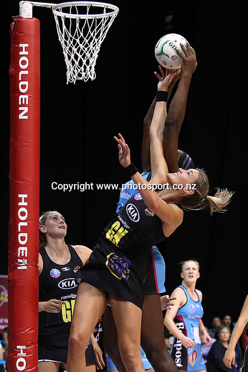 Waikato BOP Magic's Leana De Bruin goes up against Southern Steel's Jhaniele Fowler-Reid during the ANZ Netball Championship - Waikato BOP Magic v Southern Steel at Claudelands Arena, Hamilton on Monday 17 March 2014. Photo: Bruce Lim / www.photosport.co.nzz