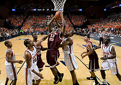 Virginia Tech forward J.T. Thompson (33) shoots over Virginia forward Adrian Joseph (30) and Virginia forward/center Jerome Meyinsse (55).  The Virginia Cavaliers men's basketball team fell to the Virginia Tech Hokies 70-69 in overtime at the John Paul Jones Arena in Charlottesville, VA on January 16, 2008.