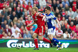 LIVERPOOL, ENGLAND - Saturday, April 23, 2011: Liverpool's Dirk Kuyt and Birmingham City's Liam Ridgewell during the Premiership match at Anfield. (Photo by David Rawcliffe/Propaganda)