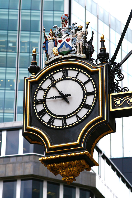 Clock outside Royal Exchange, City of London
