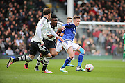 Cardiff City midfielder, Craig Noone (11) holding off 2 Fulham players during the Sky Bet Championship match between Fulham and Cardiff City at Craven Cottage, London, England on 9 April 2016. Photo by Matthew Redman.