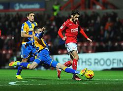 Matthew Sadler of Shrewsbury Town tackles John Goddard of Swindon Town - Mandatory by-line: Nizaam Jones/JMP - 07/01/2017 - FOOTBALL - County Ground - Swindon, England - Swindon Town v Shrewsbury Town - Sky Bet League One