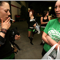Becky Durham, left, smokes a cigarette as Hope Renee waits for a ride at Galaxy Sports in Kinston, N.C. After practice the girls, most of whom smoke walk out with cigarettes in their mouths and light up before leaving.