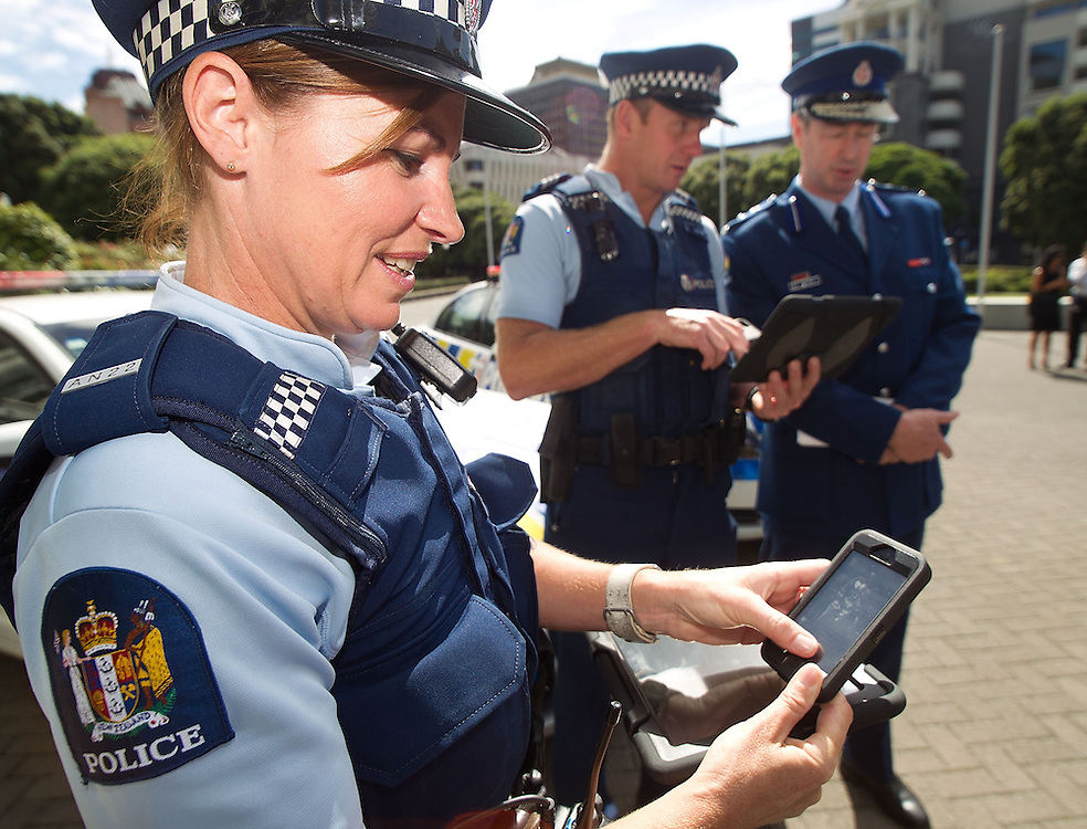 Const Harriet Murray shows the Police's newly issued iPads and iPhones during a press conference at Parliament, Wellington, New Zealand, Wednesday, February 13, 2013. Credit: SNPA / Marty Melville