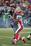 SEATTLE - NOVEMBER 28:  Linebacker Niko Koutouvides #53 of the Seattle Seahawks is defended by Nate Clements #22 of the Buffalo Bills at Qwest Field on November 28, 2004 in Seattle, Washington. The Bills defeated the Seahawks 38-9. ©Paul Anthony Spinelli *** Local Caption *** Niko Koutouvides; Nate Clements