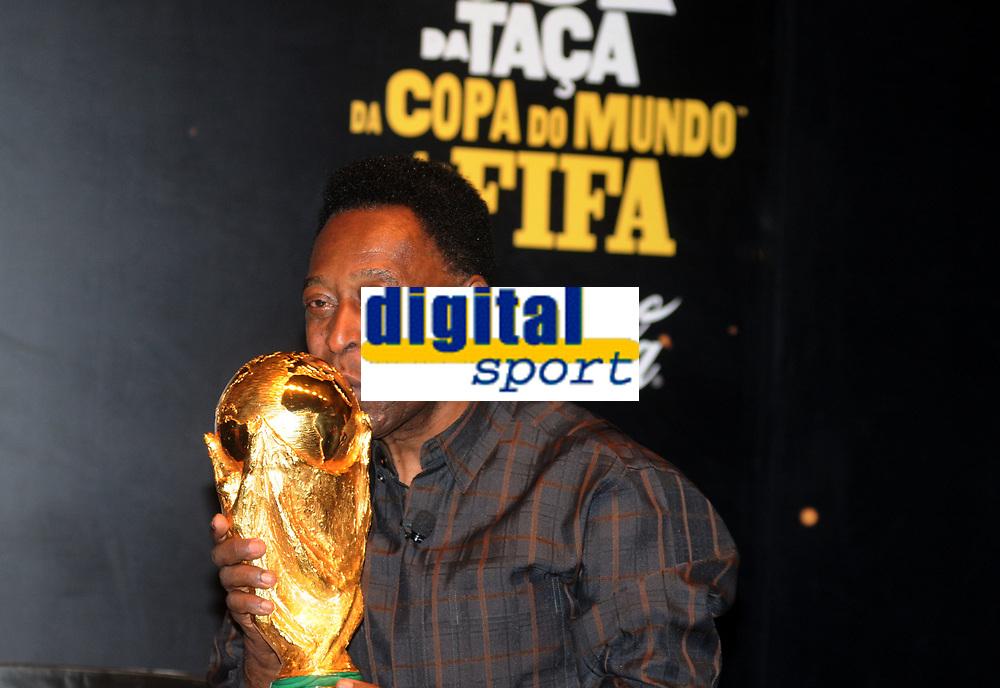 20100206: RIO DE JANEIRO BRAZIL - Brazilian football star Pele holds FIFA trophy. The World Cup Trophy has arrived to Forte De Copacabana in Rio, Brazil<br /> PHOTO: CITYFILES