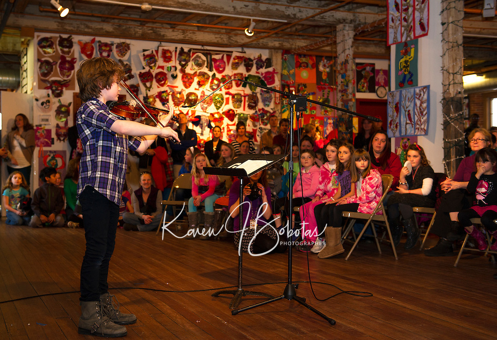 """Gilford Elementary student Dylan Hamel performs """"Oh, Susannah"""" during opening night for Arts Alive at the Belknap Mill Thursday evening.   (Karen Bobotas/for the Laconia Daily Sun)"""
