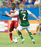 FRISCO, TX - JUNE 26:  Jair Benitez #5 of FC Dallas is defended by Ryan Miller #2 of the Portland Timbers on June 26, 2013 at FC Dallas Stadium in Frisco, Texas.  (Photo by Cooper Neill/Getty Images) *** Local Caption *** Jair Benitez